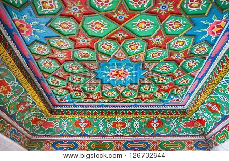 KOKAND UZBEKISTAN - MAY 6 2015: The carved stars on the room's ceiling in Khudayar Khan Palace boasts the variety of shapes and patterns on May 6 in Kokand.