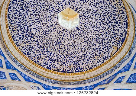 KOKAND UZBEKISTAN - MAY 6 2015: The blue cupola of the entrance gate of of Khudayar Khan Palace covered by fine white patterns on May 6 in Kokand.