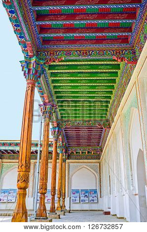 KOKAND UZBEKISTAN - MAY 6 2015: The terrace in the courtyard of Khudayar Khan Palace with the colorful wooden ceiling and slender pillars on May 6 in Kokand.