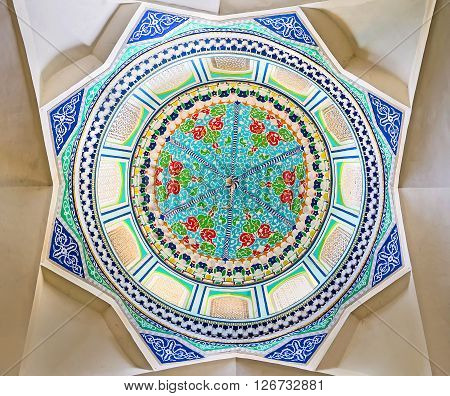 KOKAND UZBEKISTAN - MAY 6 2015: The cupola of the Norbut-biy Mosque has form of octagonal star and decorated with the frescos depicting the colorful floral ornamentation on May 6 in Kokand.