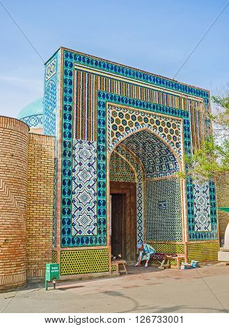 KOKAND UZBEKISTAN - MAY 6 2015: The Damoi Shakhon Burial Vault covered by colorful glazed tiles of unusual color gamma and patterns on May 6 in Kokand.