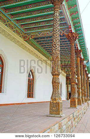 KOKAND UZBEKISTAN - MAY 6 2015: The carved wooden details are very popular in decor of the Uzbek landmarks such as these pillars in Jami Mosque on May 6 in Kokand.