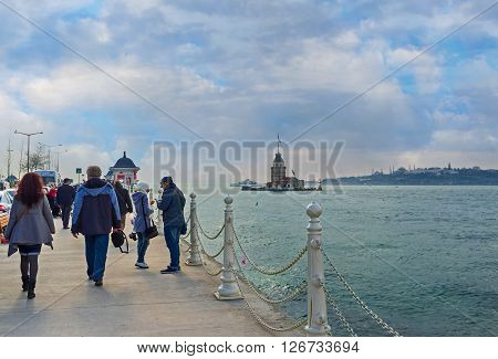 ISTANBUL TURKEY - JANUARY 21 2015: Many tourists visit Uskudar embankment to watch or visit the Maiden's Tower on January 21 in Istanbul.