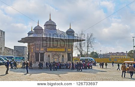 ISTANBUL TURKEY - JANUARY 21 2015: The scenic ablution fountain (sadirvan) in front of the gate of the Topkapi Palace on January 21 in Istanbul.