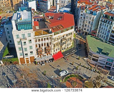 The aerial view on the neighborhood surrounding Galata Tower with numerous cafes and shops Istanbul Turkey