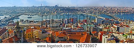 The Galata Tower overlooks three central bridges of Istanbul - Galata bridge Metro bridge and Ataturk bridge connecting Beyoglu and Fatih districts Turkey.