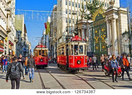 ISTANBUL TURKEY - JANUARY 22 2015: Two red trams stands on the station next to the main gate to the Galatasaray High School on January 22 in Istanbul.