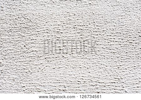 coarse grey plaster wall for background or texture