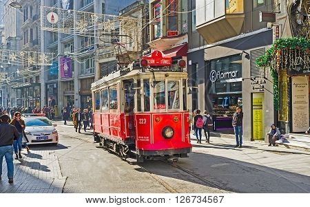 ISTANBUL TURKEY - JANUARY 22 2015: The Independence Avenue is the famous shopping area that boasts the Nostalgia Tramway connecting the Taksim Square and Tunel on January 22 in Istanbul.