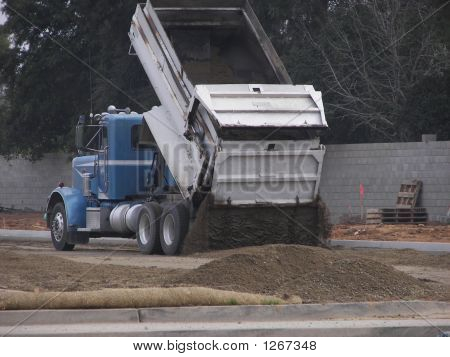 Truck Pouring Out The Gravel