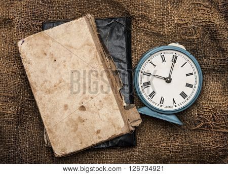 vintage alarm clock on vintage background