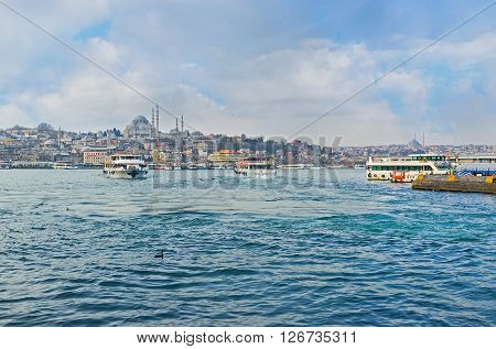 ISTANBUL TURKEY - JANUARY 21 2015: The cityscape of Istanbul from Galata vridge with many ferries connecting the different banks on January 21 in Istanbul.
