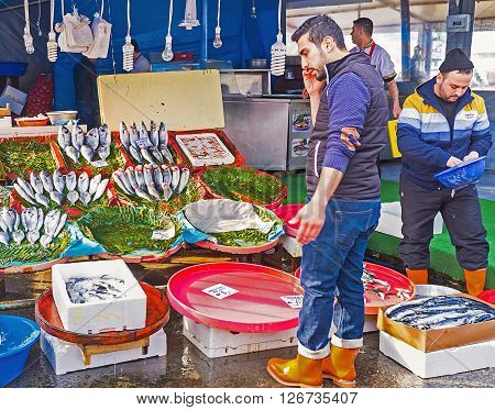 ISTANBUL TURKEY - JANUARY 21 2015: The central fish market next to Galata bridge is always busy and crowded place on January 21 in Istanbul.