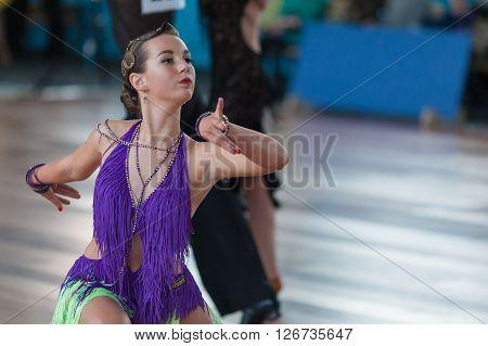 Minsk Belarus -April 3 2016: Unidentified Female Dance Performs Juvenile-2 Latin-American Program on IDSA Championship Kinezis Star Cup - 2016 in April 3 2016 in Minsk Republic of Belarus