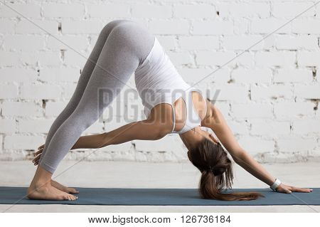 Yoga Indoors: Revolved Downward-facing Dog Pose