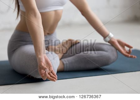 Yoga Indoors: Woman Meditating