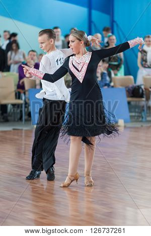 Minsk Belarus -April 3 2016: Makey Zahar and Sokolova Varvara Perform Youth Latin-American Program on IDSA Championship Kinezis Star Cup - 2016 in April 3 2016 Minsk Republic of Belarus