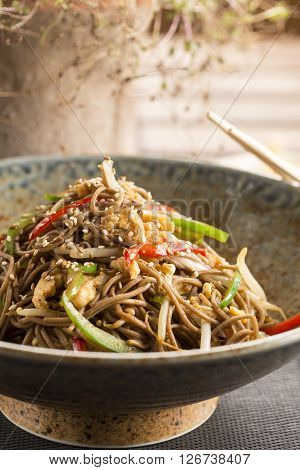 Yasai yaki soba noodles, enoki mushroom, peppers, spring onions & sesame seeds