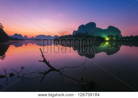 Beautiful sunrise landscape at lake in Phang nga province, Thailand.