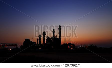 Gas turbine electrical power plant at dusk with light