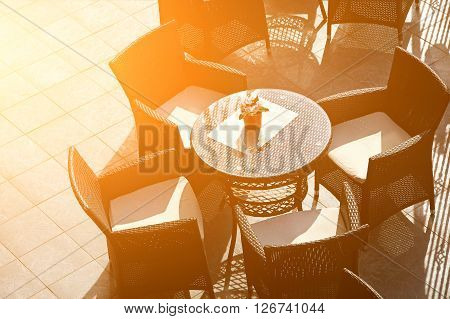 Street view of a Cafe terrace with empty tables and chairs