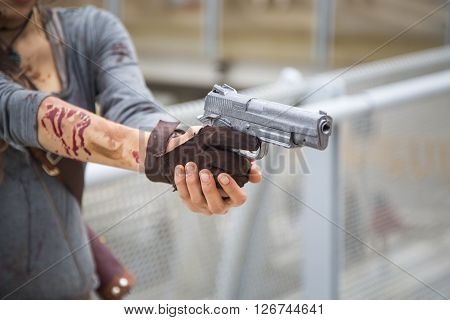 Woman pointing a 9mm pistol to the right