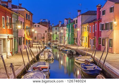 Canal and colorful houses in the evening on Burano Island Venice Italy