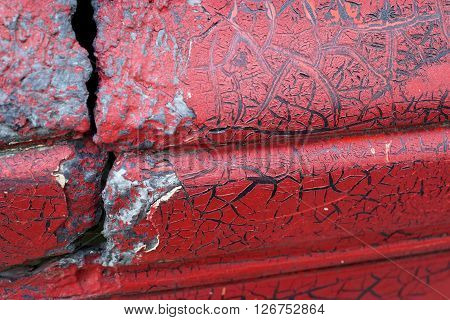 Cracked Red Paint On Grunge Metal Surface - Macro 2