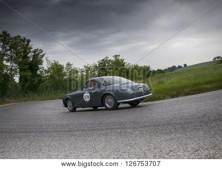 PESARO, ITALY - MAY 15: Sprint 1900 di ALFA ROMEO C Pininfarina 1953 on an old racing car in rally Mille Miglia 2015 the famous italian historical race (1927-1957) on May 2015