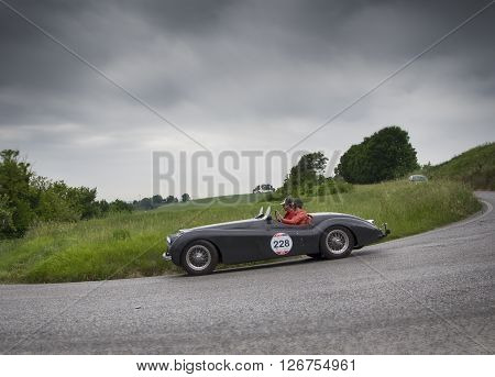 PESARO, ITALY - MAY 15: JAGUAR XK 120 OTS Roadster 195 on an old racing car in rally Mille Miglia 2015 the famous italian historical race (1927-1957) on May 2015