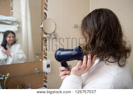 Young Woman Drying Her Hair