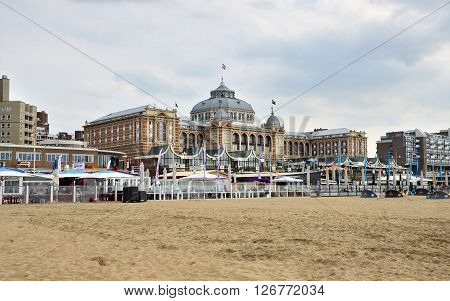 The Hague Netherlands - May 8 2015: Tourists at Kurhaus of Scheveningen or Grand Hotel Amrath Kurhaus The Hague. It is located in the main seaside resort area near the beach.