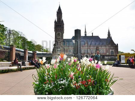 The Hague Netherlands - May 8 2015: Reporters at The Peace Palace in The Hague Netherlands. It is often called the seat of international law because it houses the International Court of Justice.
