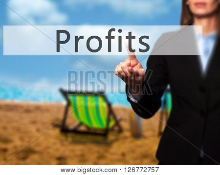 Profits - Businesswoman Hand Pressing Button On Touch Screen Interface.