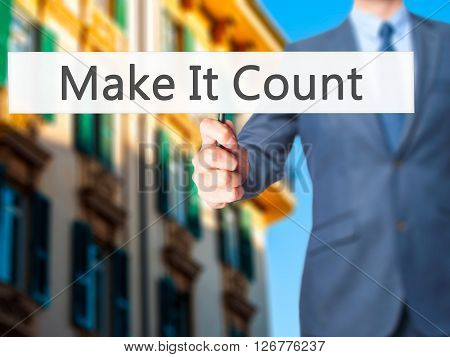 Make It Count - Businessman Hand Holding Sign