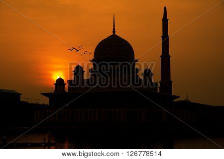 Silhouette of Putrajaya red mosque during sunrise in Malaysia