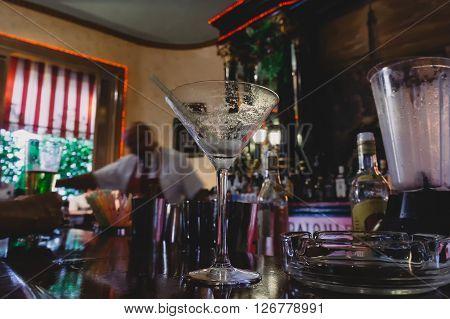 Empty daiquiri cocktail glass on bar counter