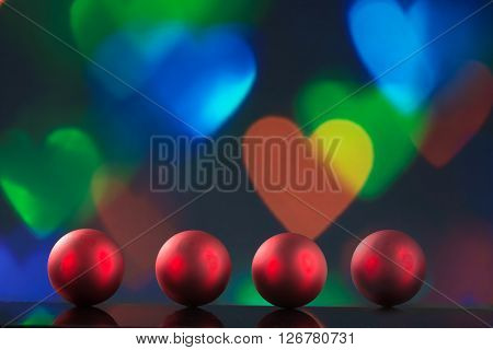 Christmas background with blury heart colored decoration