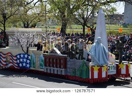 WASHINGTON, DC - APR 16: Washington monuments float at the 2016 National Cherry Blossom Parade in Washington DC, as seen on April 16, 2016. Thousands of visitors gathered to attend this annual event.