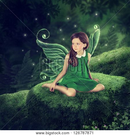 Little fairy girl sitting in the forest