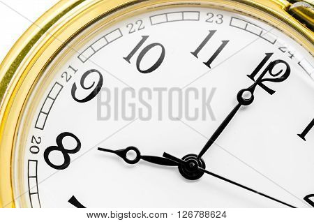 Close up gold clock face on white background.