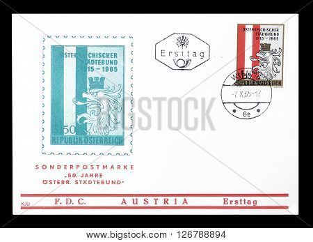 AUSTRIA - CIRCA 1965 : Cancelled First Day Cover letter printed by Austria, that shows Eagle head and Austrian flag.