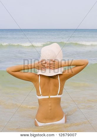 Serenity and peace. Woman watching the sea