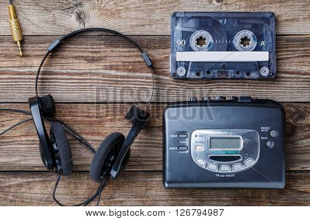 Music concept. Top view of cassette tape, audio player and headphones.