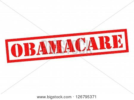 OBAMACARE red Rubber Stamp over a white background.