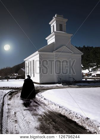 Puritan woman walking past a church in winter at nighttime