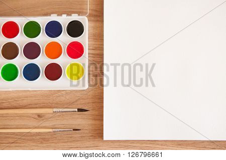 Artist's Work Space. Set Of Watercolor Paints In White Base, Sheet Of White Watercolor Paper, 2