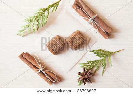 Raw Candies Made Of Date Fruit,nuts Decorated With Cinnamon Sticks,cardamom,thuja Branches On Light