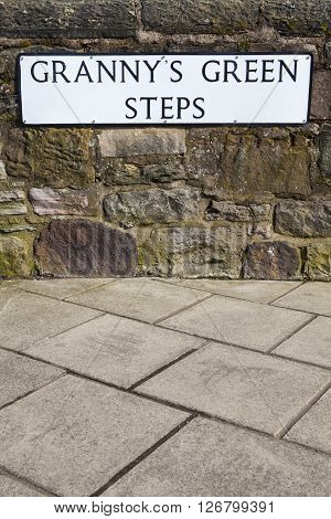 The street sign for Grannys Green Steps in the historic city of Edinburgh Scotland.