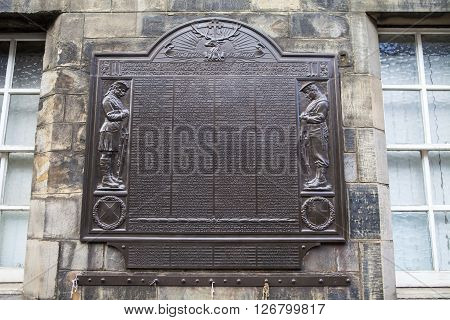 EDINBURGH SCOTLAND - MARCH 10TH 2016: A memorial on Canongate Tolbooth in Edinburgh dedicated to the memory of the men from the old Burgh of Canongate who lost their lives during the Great War taken on 10th March 2016.